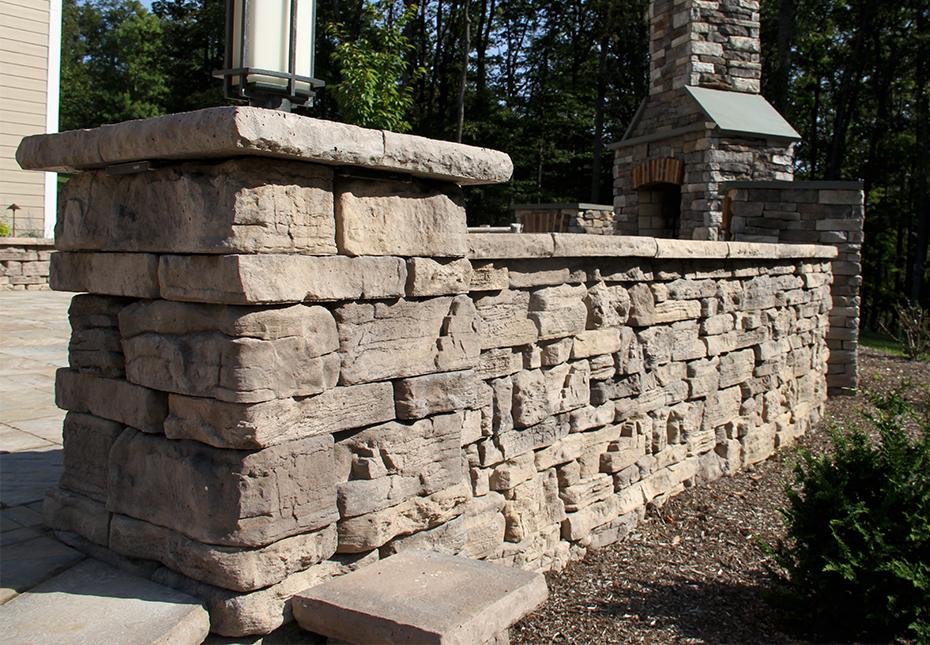 Rosetta Belvedere Wall & Rosetta Dimensional Coping & Column Caps in Saddle