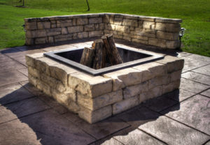 Rosetta Dimensional Round Fire Pit & Rosetta Belvedere Wall in Saddle
