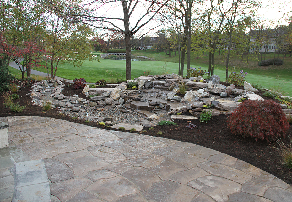 Rosetta Grand Flagstone & Rosetta Outcropping Wall in Saddle