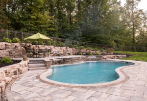 Rosetta Outcropping Wall in Saddle | Rosetta Dimensional Flagstone & Rosetta Belvedere Fire Pit in Canyon