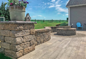 Napa Wall and StoneLedge Fire Pit in Mesquite | 12x48 Planks in Soul Grey