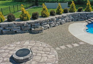 Outcropping Wall, Belvedere Wall & Coping, Belvedere Fire Pit and Grand Flagstone in Ash