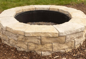 Dimensional Round Fire Pit in Saddle